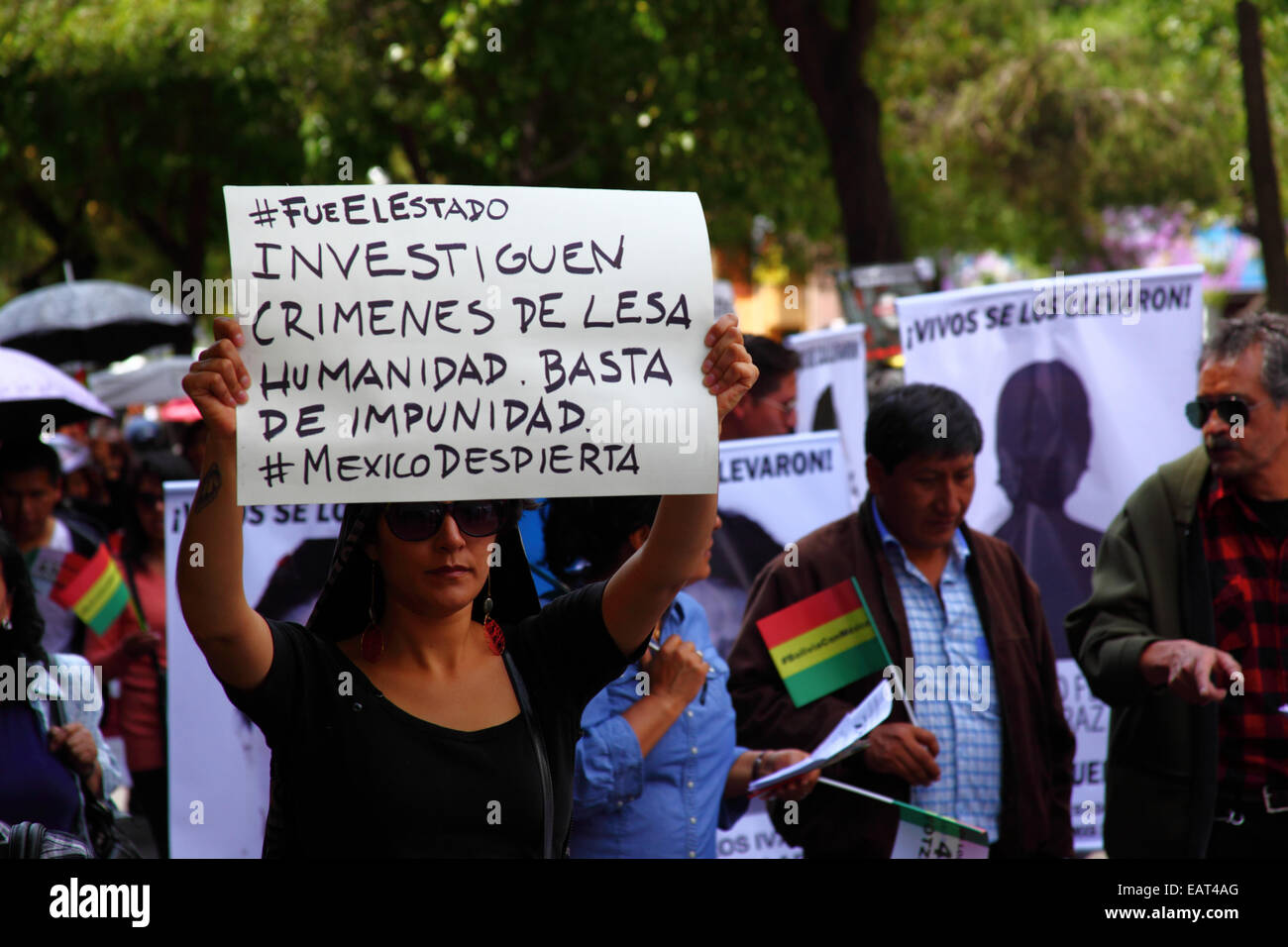 La Paz, Bolivia. 20th November, 2014. A protester holds a placard demanding an investigation into crimes against Stock Photo