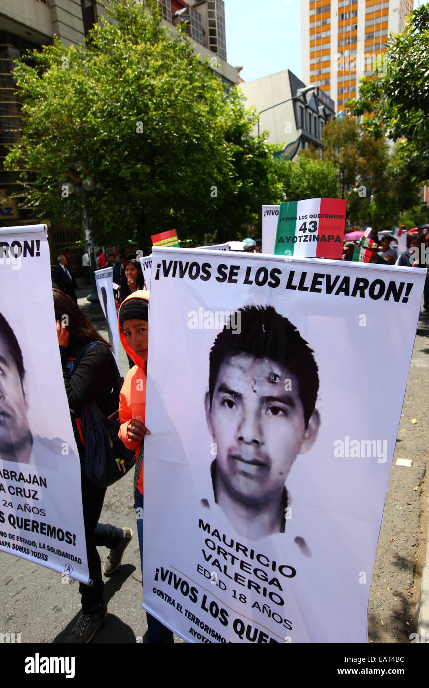 La Paz, Bolivia. 20th November, 2014. Protesters march with banners with pictures of the missing to demand justice Stock Photo