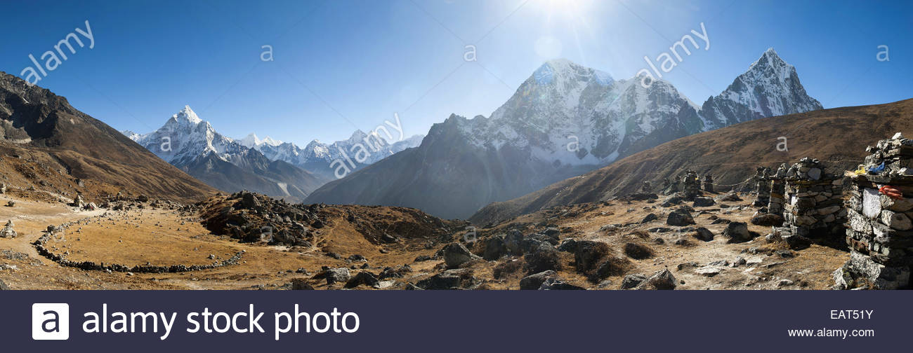 Remembrance chortens near Lobuche with Ama Dablam in the distance - Stock Image