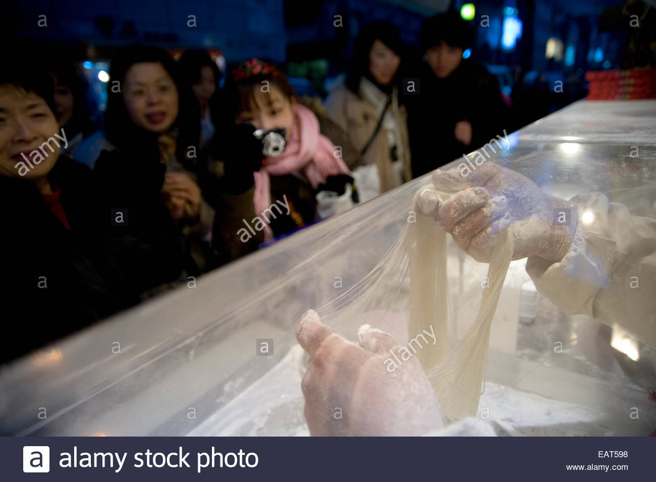 A baker makes 'Ggul Tae Reh,' or candy, in the Insadong neighborhood. Stock Photo