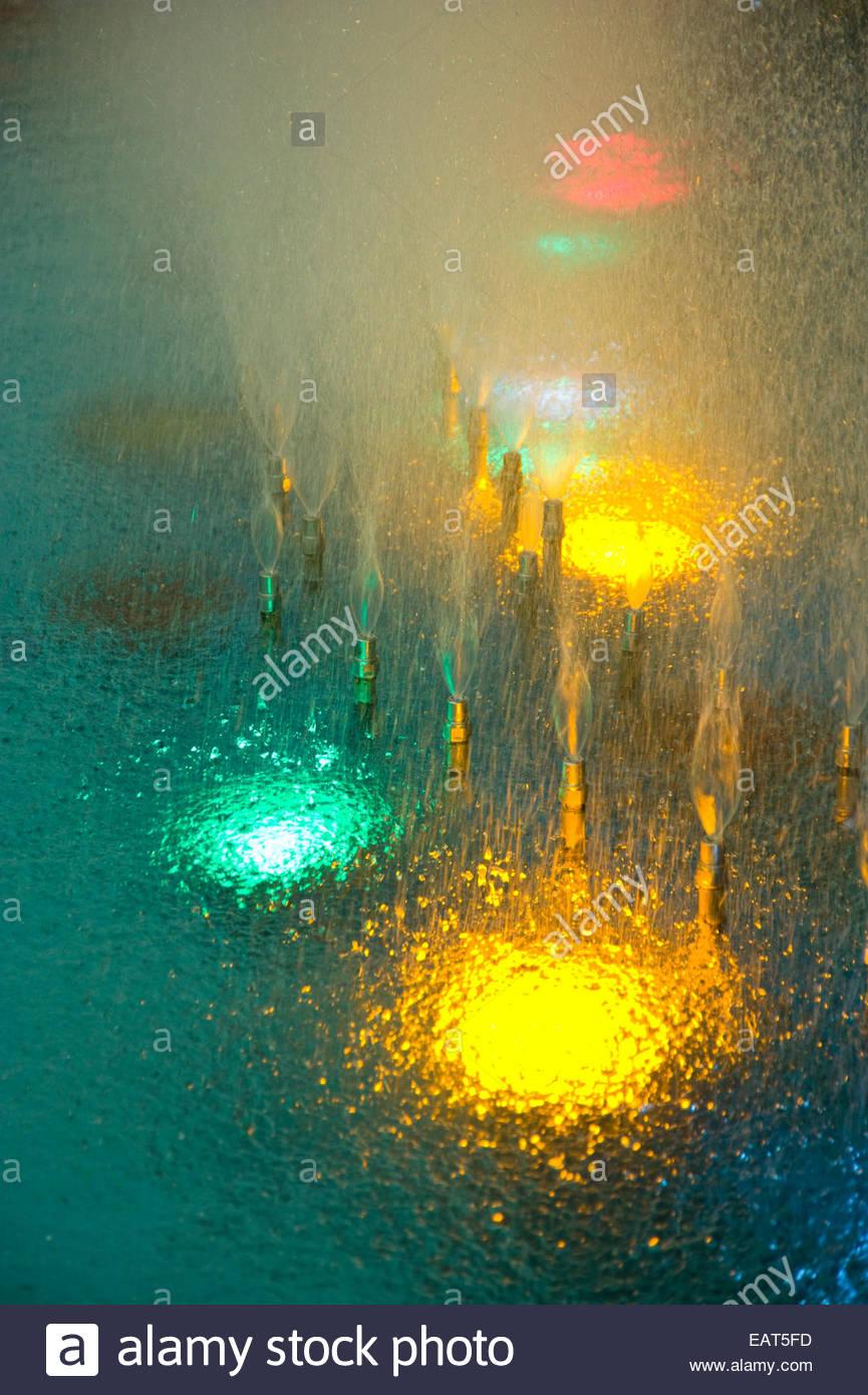 Lotte World Amusement Park's decorative lights shine in a fountain. Stock Photo