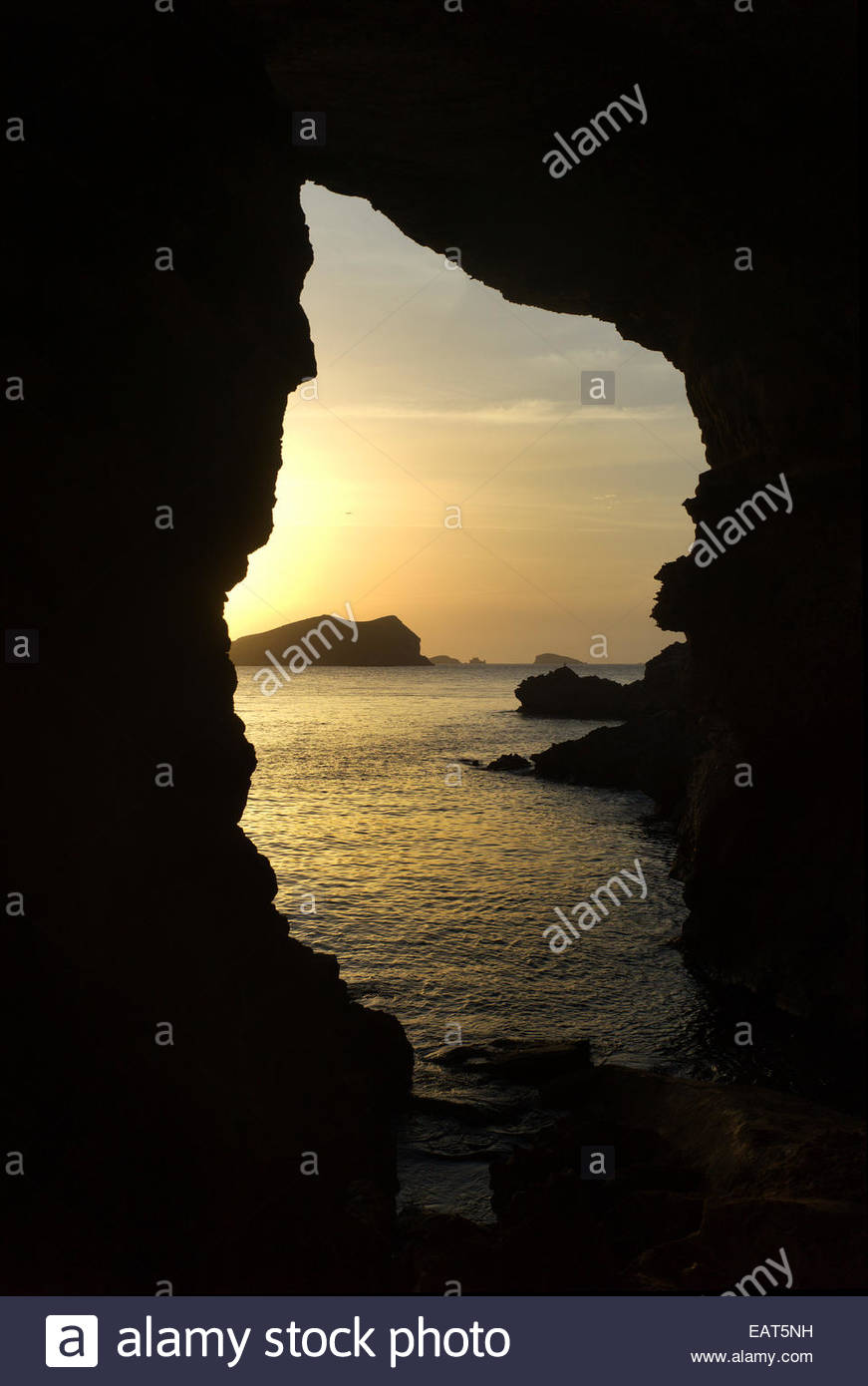 The Sa Figuera Borda Cave at Platges de Comte beach on Ibiza Island. - Stock Image