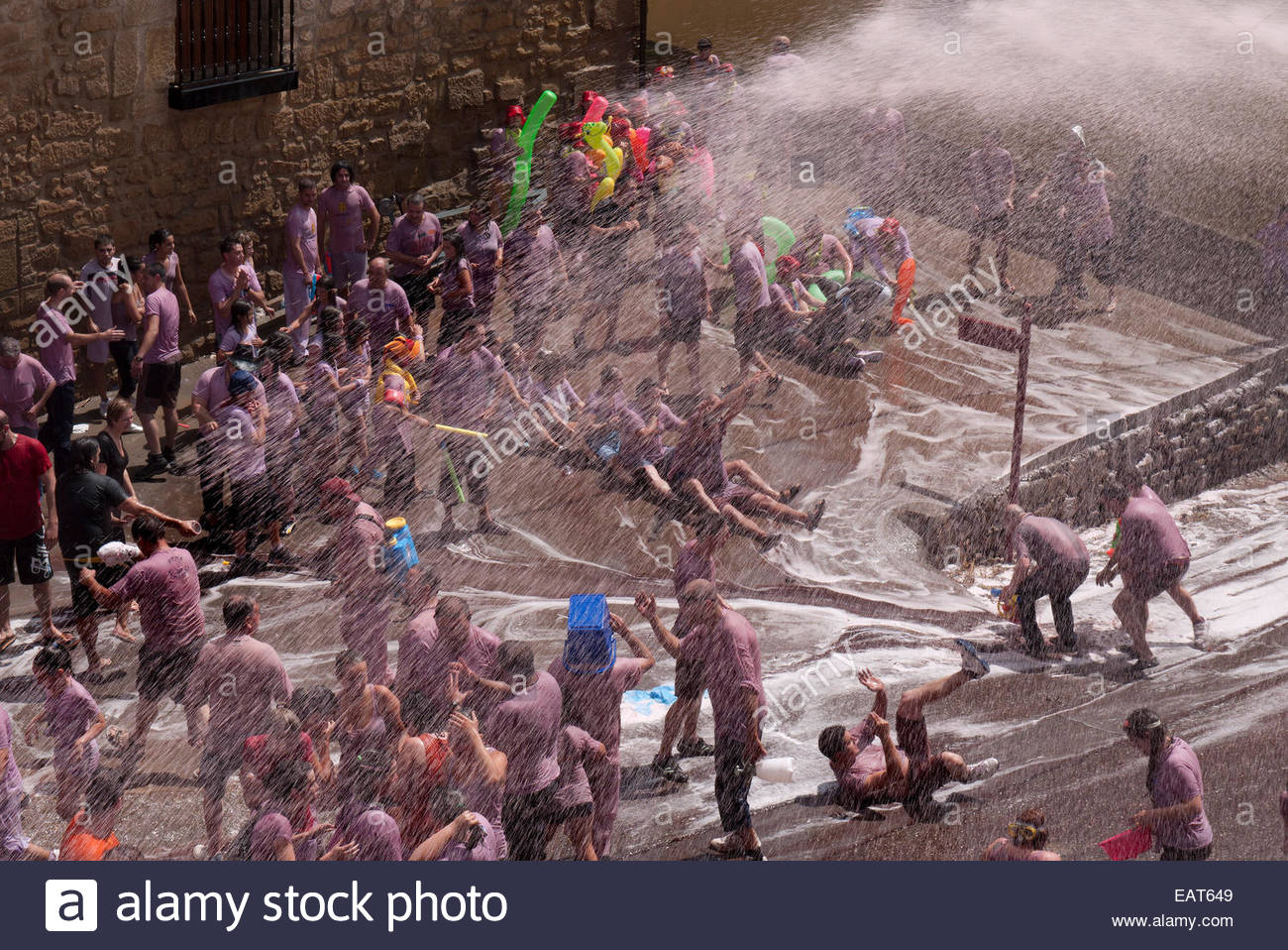 People participating in the Battle of Wine Festival in San Asensio, Spain. Stock Photo
