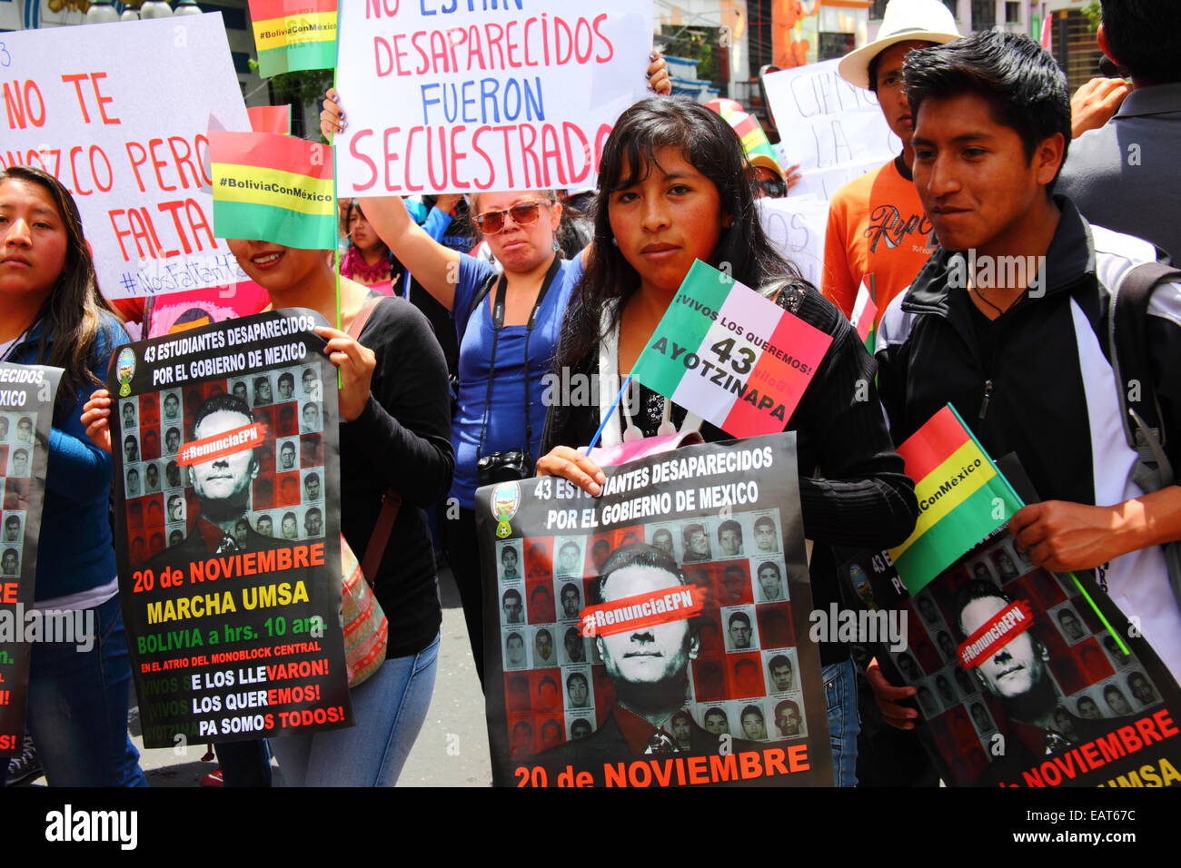 La Paz, Bolivia. 20th November, 2014. Protesters march to demand justice for the 43 missing students in Mexico and Stock Photo