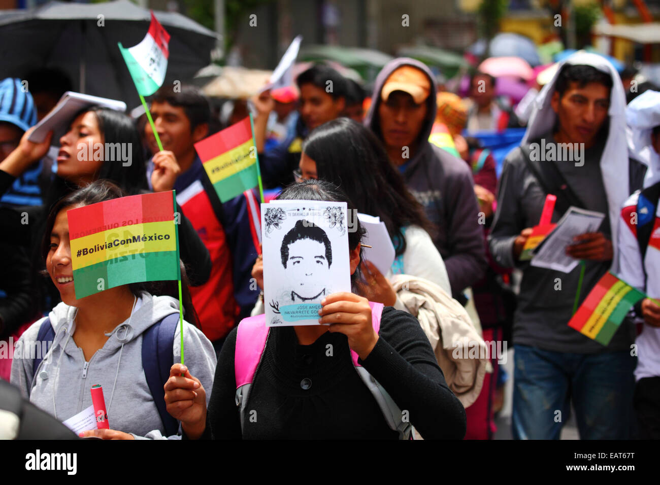 La Paz, Bolivia. 20th November, 2014. A protester holds a picture of one of the missing during a march to demand Stock Photo