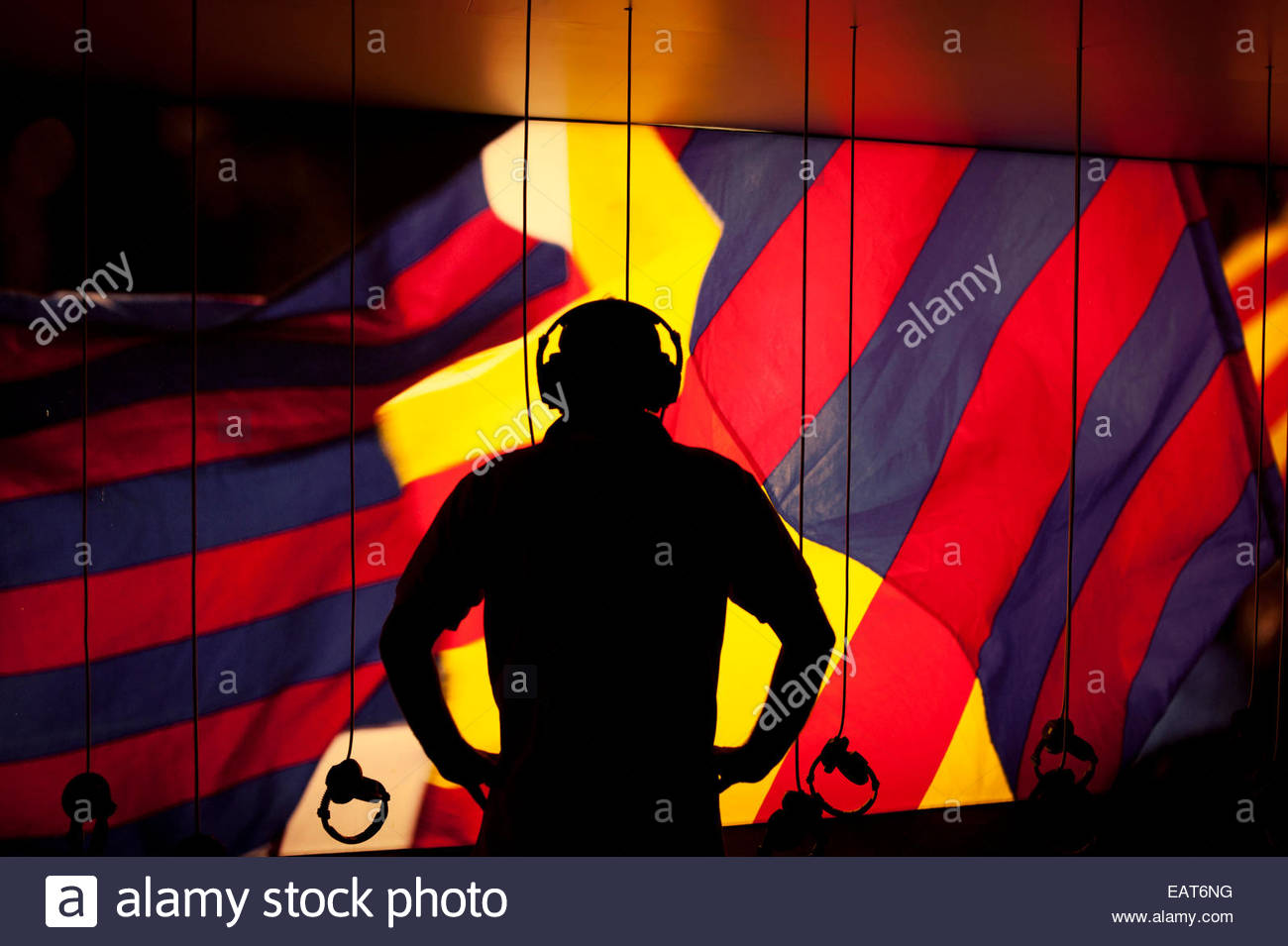 A man listening to earphones at the Futbol Club Barcelona's Barca Museum. - Stock Image