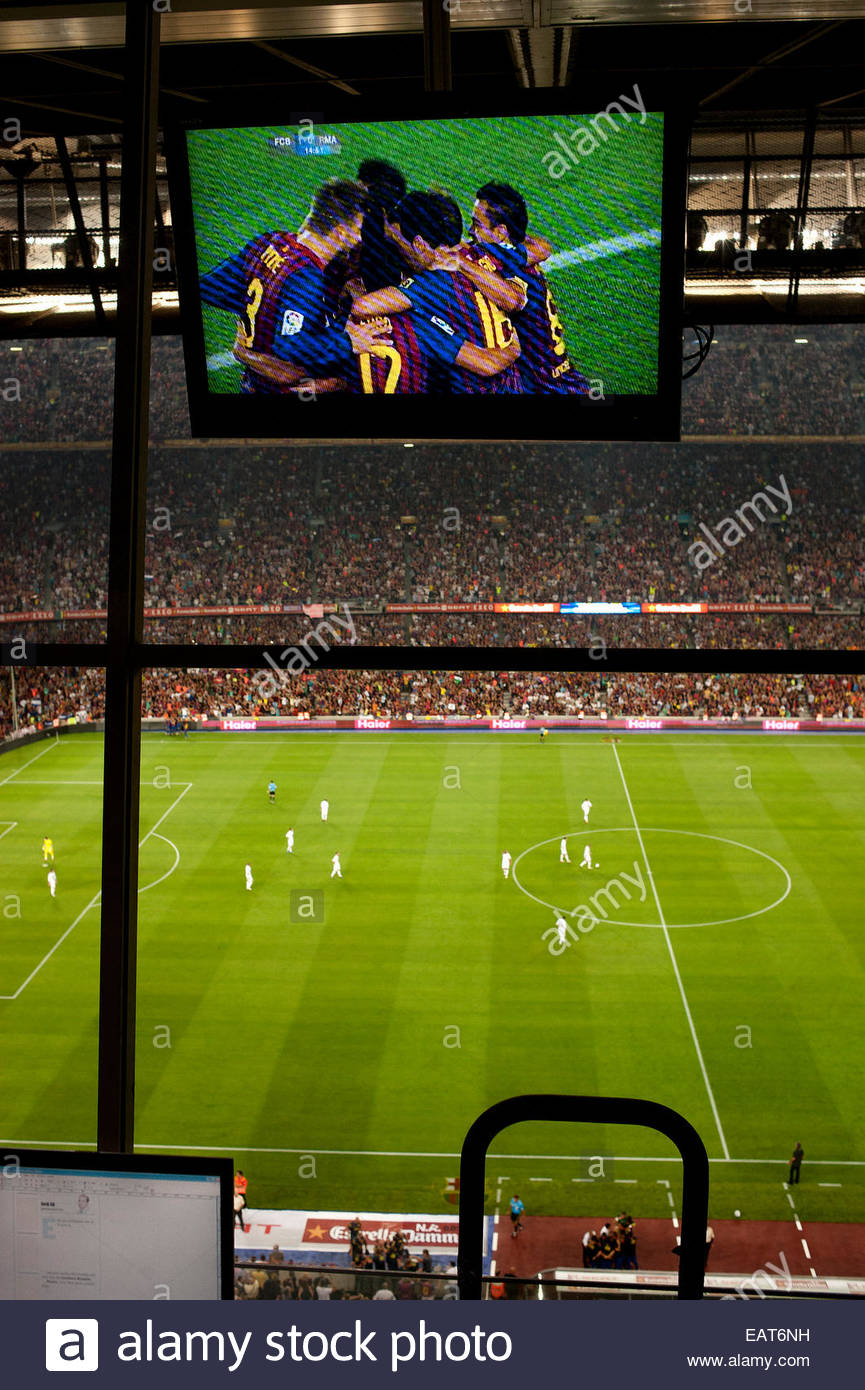 F.C. Barcelona, or Futbol Club Barcelona, is celebrating a goal during a game at the Stadium Camp Nou in Barcelona. - Stock Image