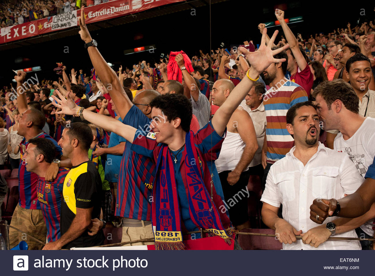 F.C. Barcelona fans at a game at Stadium Camp Nou in Barcelona. - Stock Image