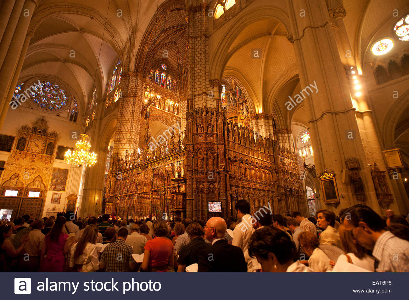 People attending mass at the Catedral de Santa Maria de Toledo. - Stock Image