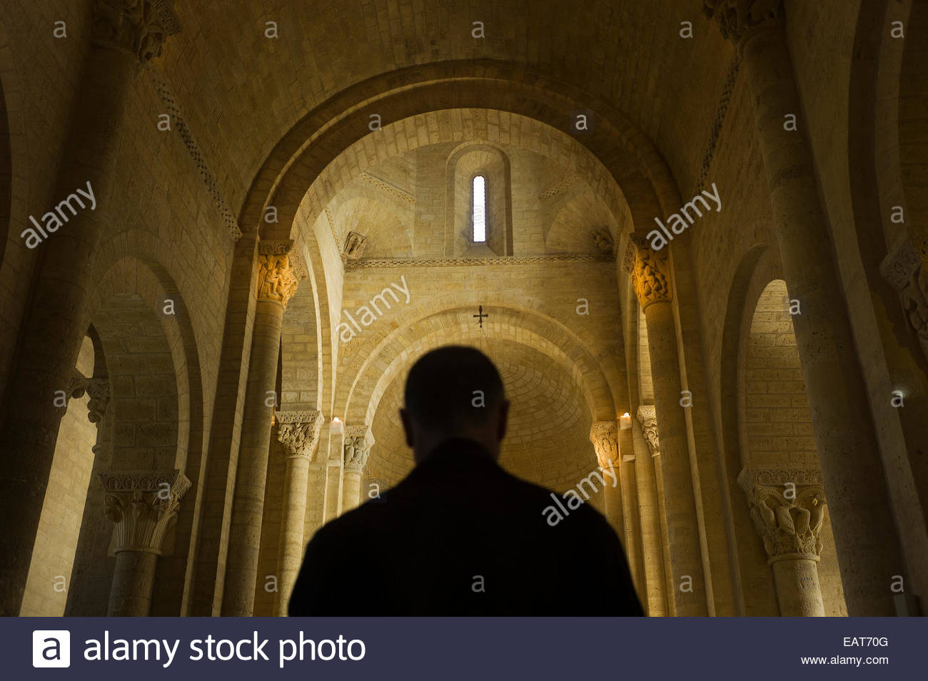 A man at the Church of St. Martin de Tours in Formista, Spain. Stock Photo