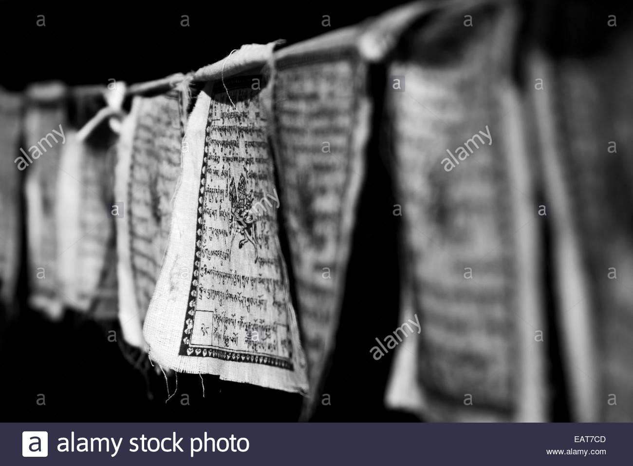 Black and white Buddhist prayer flags. Stock Photo