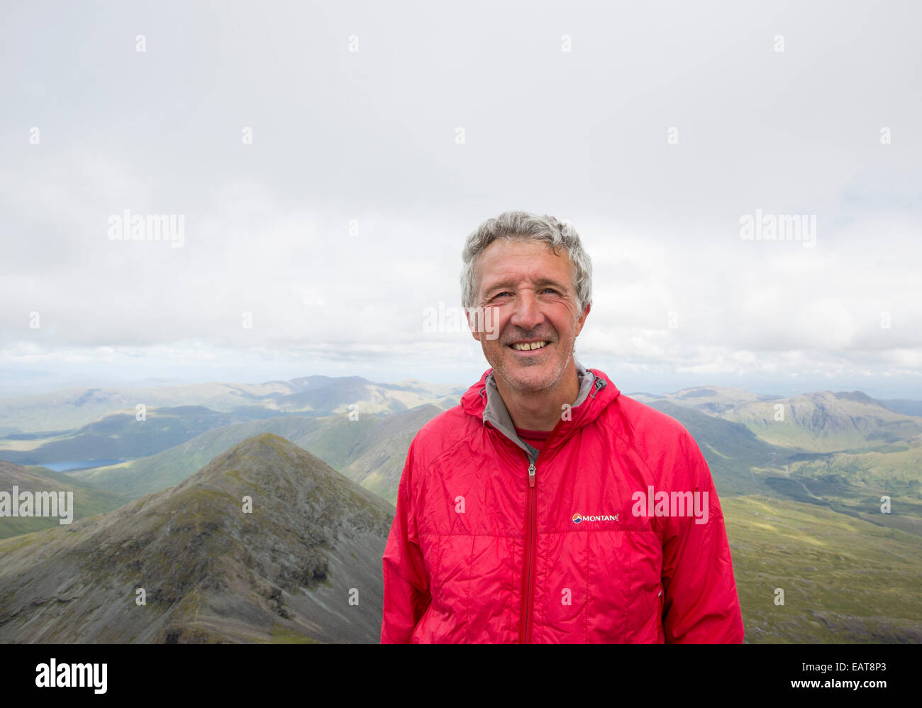 A Munro bagger on the summit of Ben More, a Munro on the Isle of Mull, Scotland, UK. - Stock Image
