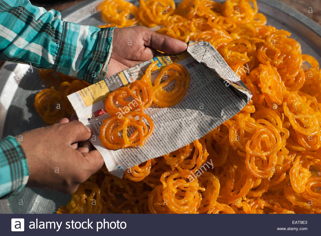 Deep fried syrupy squiggles called Jelabi are famous street food - Stock Image