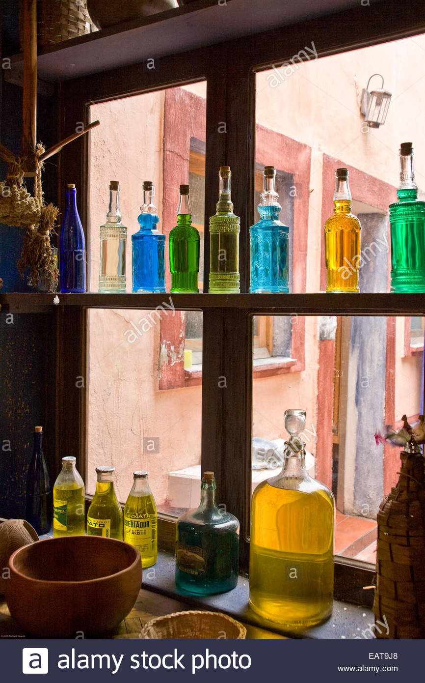 Bottles in the window of antique store. - Stock Image