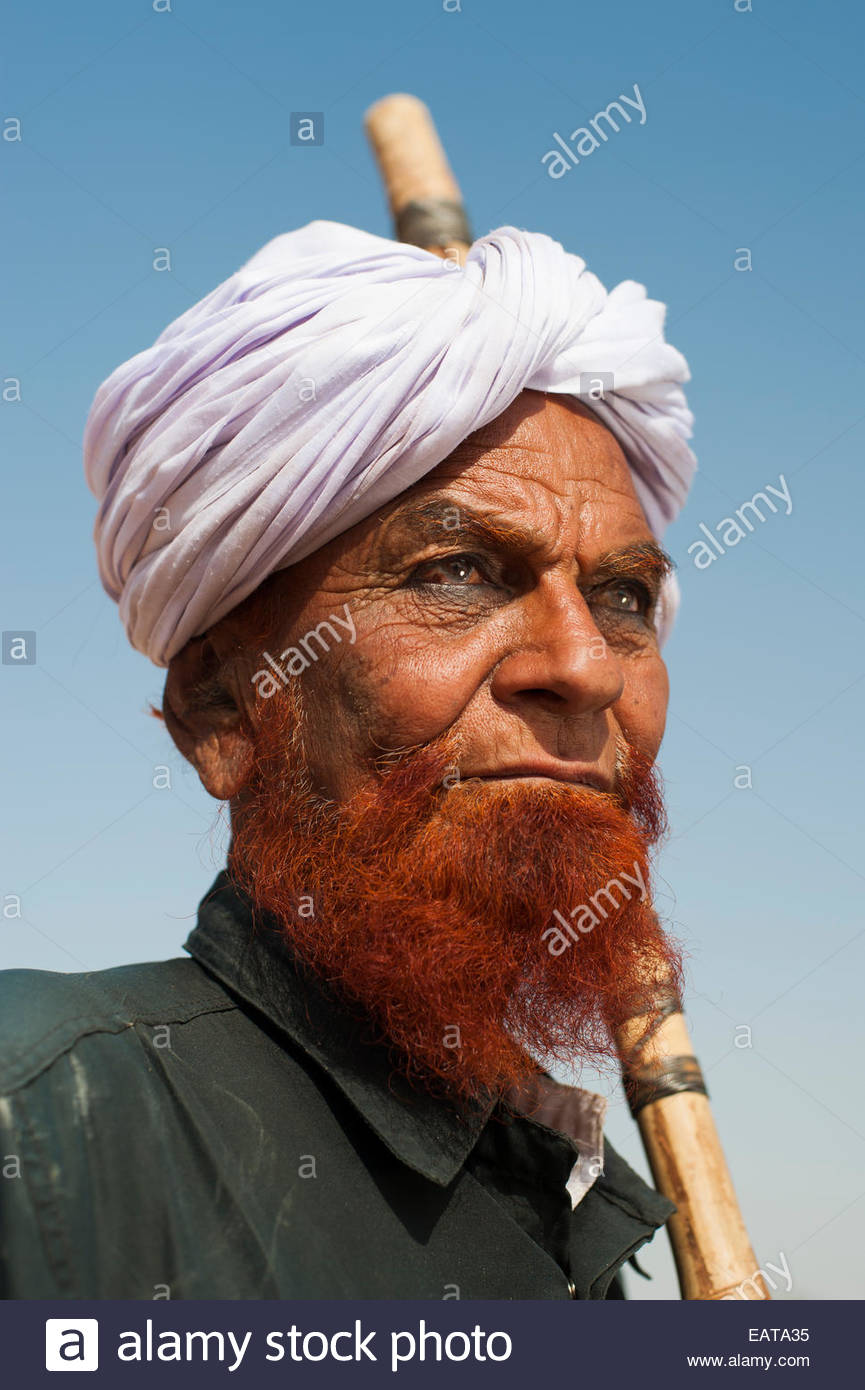 A Muslim Man With Beard Dyed In Henna With Black Khol Under Eyes