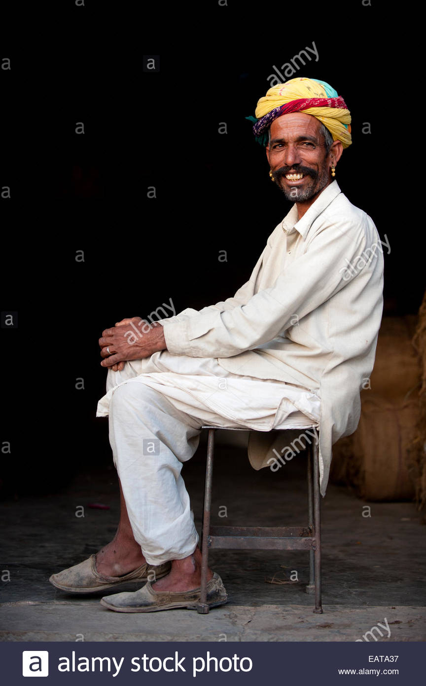 A Rajasthani man with a typically large moustache and bright turban. - Stock Image