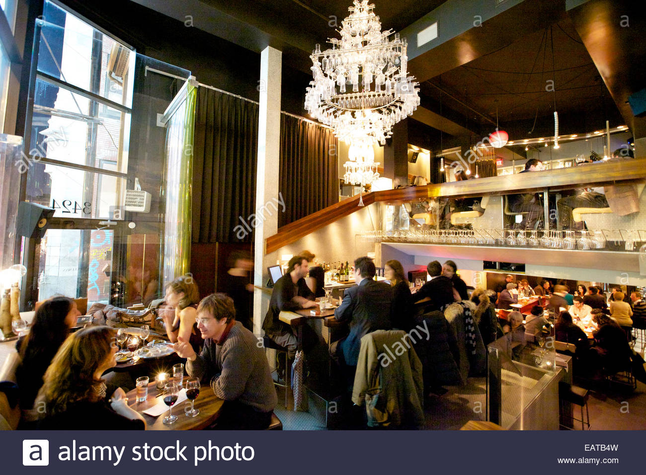 Wine serves as the leitmotif at handsomely lit 'Pullman'. - Stock Image