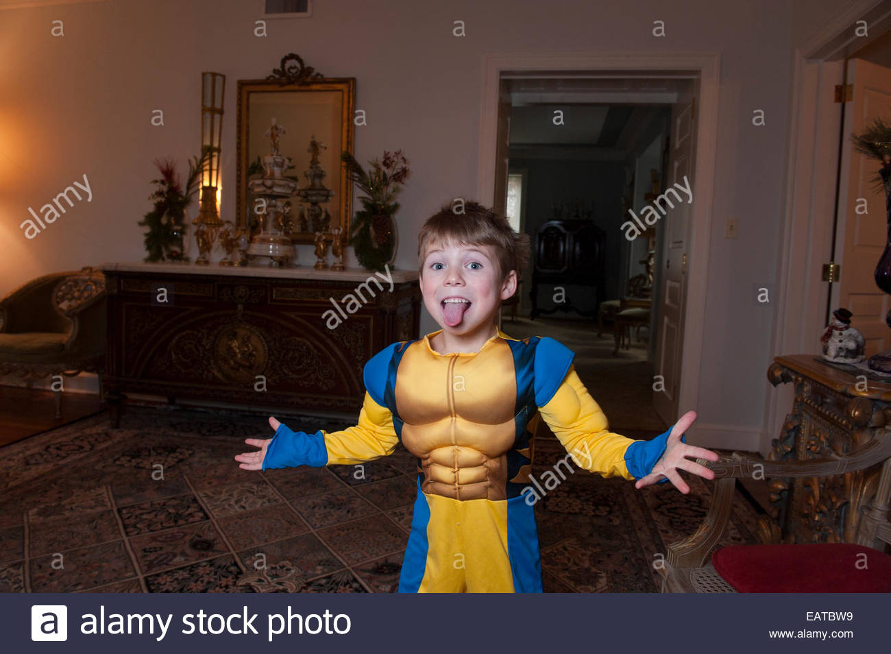 a young boy dresses up in his halloween costume at home in lincoln nebraska
