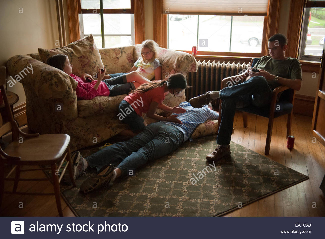A family spends time together. - Stock Image