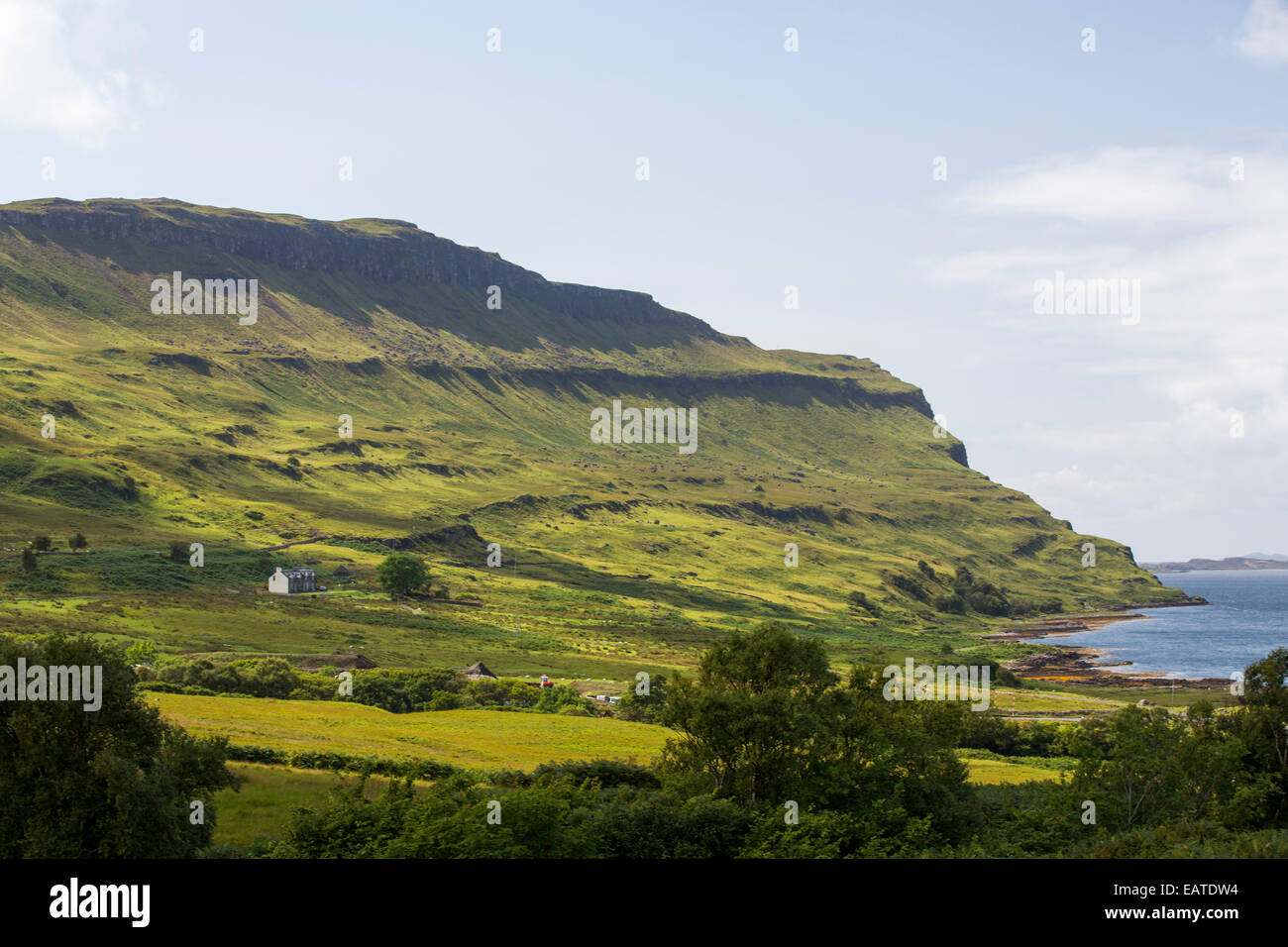 An isolated house above Loch na Keal near Ben More on the Isle of Mull, Scotland, UK. - Stock Image