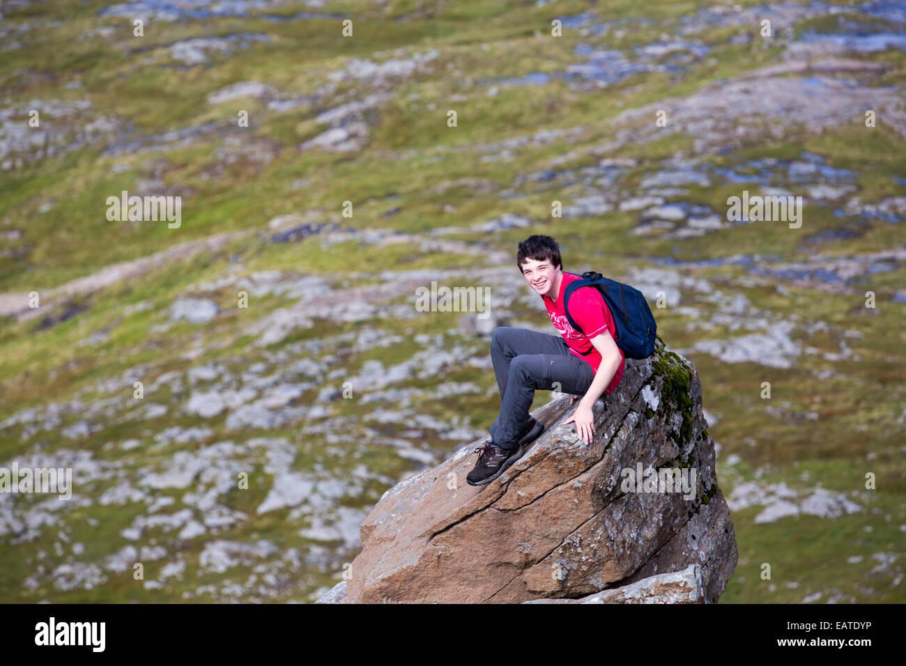 A teenager climbing the Munro on Ben More, Isle of Mull, Scotland, UK. - Stock Image