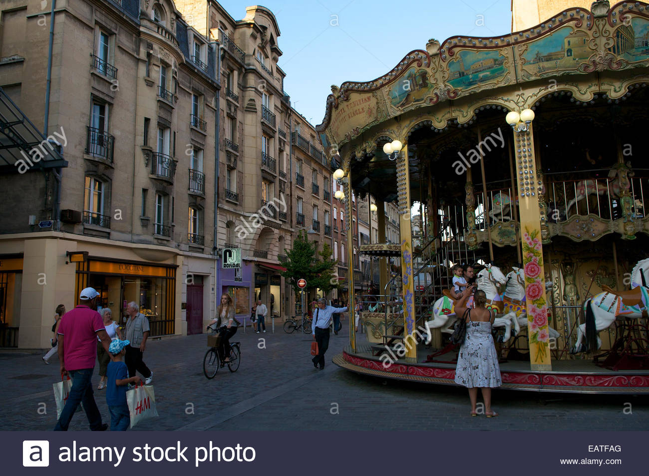 Early evening street scene in Reims, France. - Stock Image