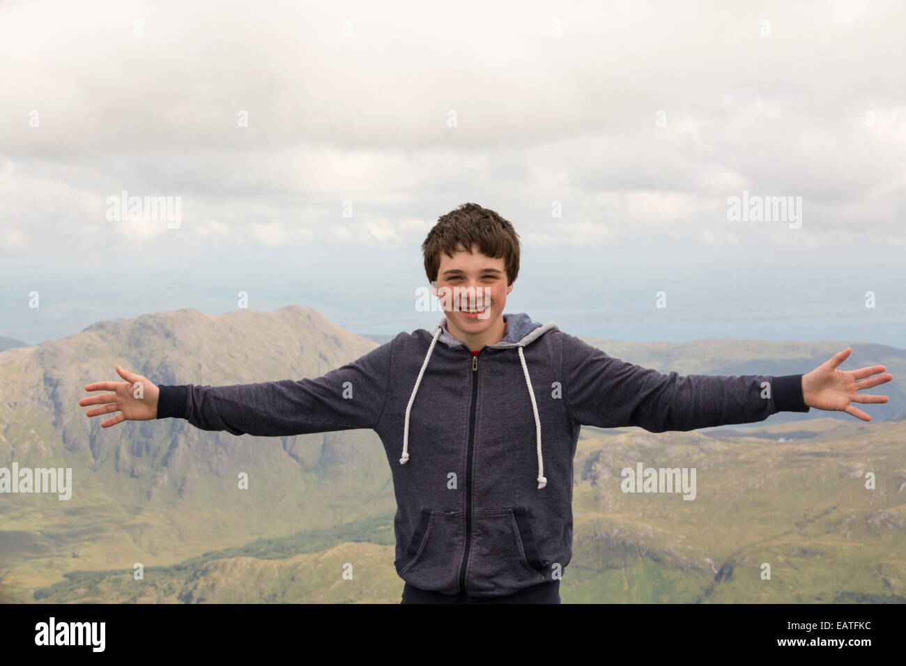 A teenager on the summit of the Munro, Ben More, Isle of Mull, Scotland, UK. - Stock Image