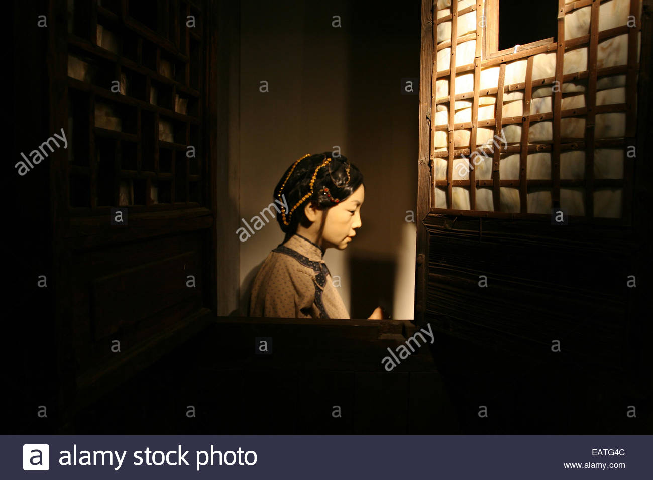 A wax model of a worker in the tourist centre in Wuzhen. - Stock Image