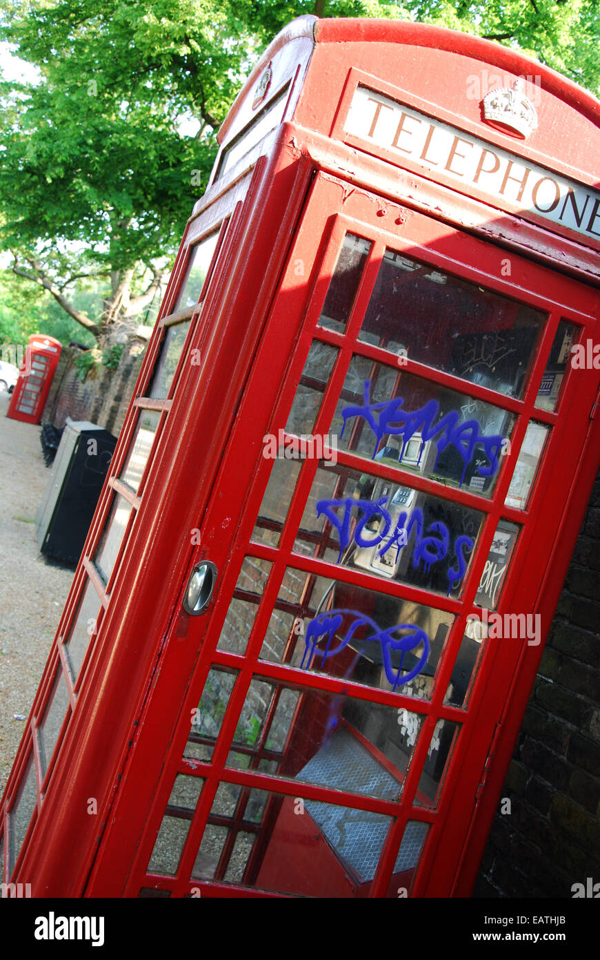 classic red phone boxes In London UK - Stock Image