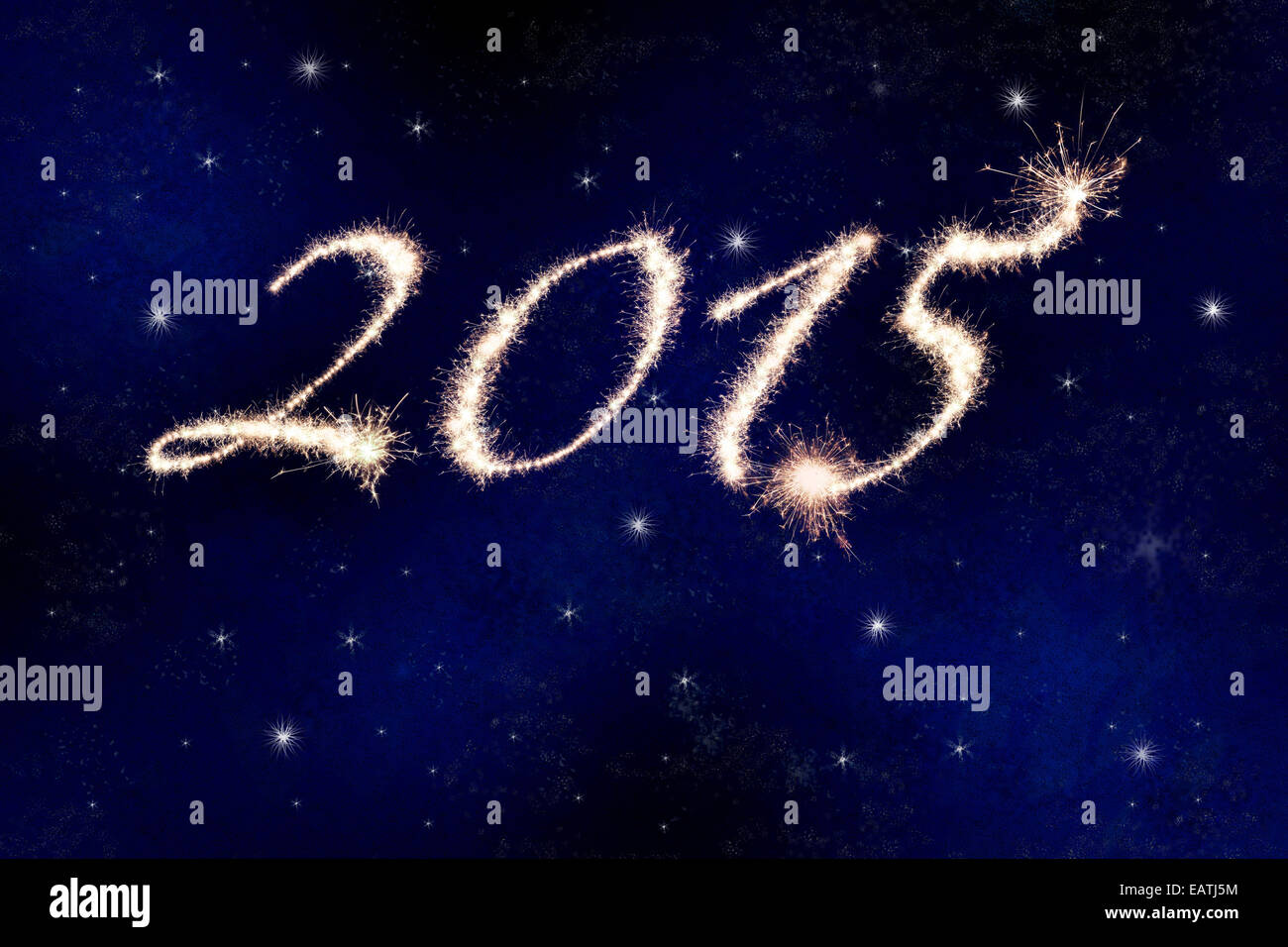2015 in fireworks or sparklers against the night sky with stars celebrating the New Year. - Stock Image