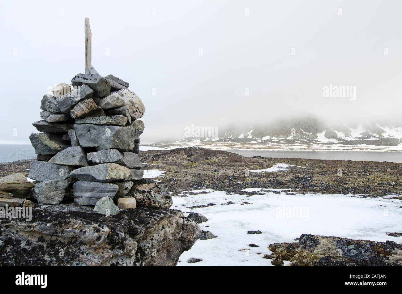 Grave cairn in the Bay of Sorrow near Magdalenefjorden. - Stock Image