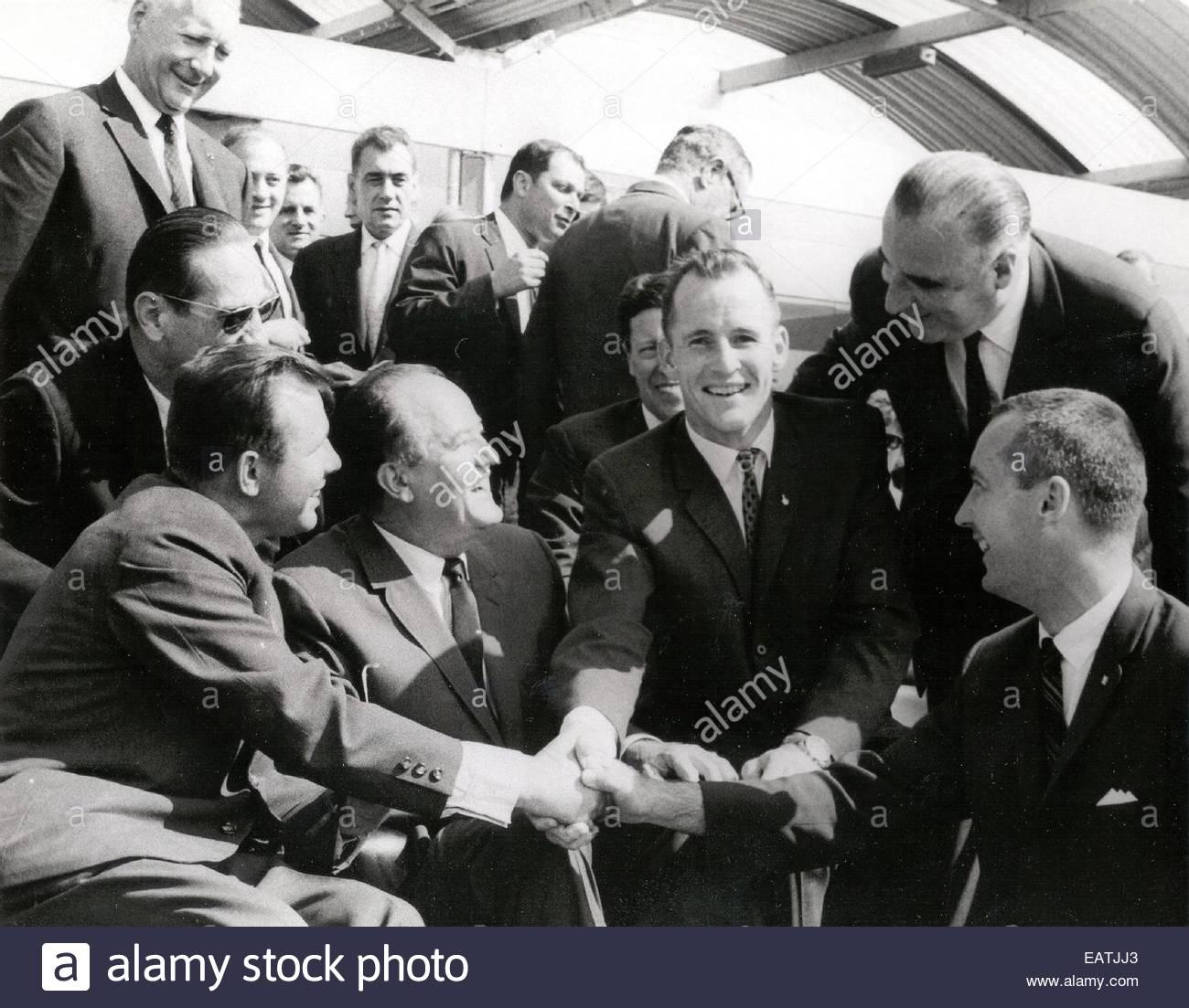 Cosmonaut Yuri Gagarin shakes hands with NASA's Gemini 4 astronauts, Edward H. White II and James A. McDivitt - Stock Image