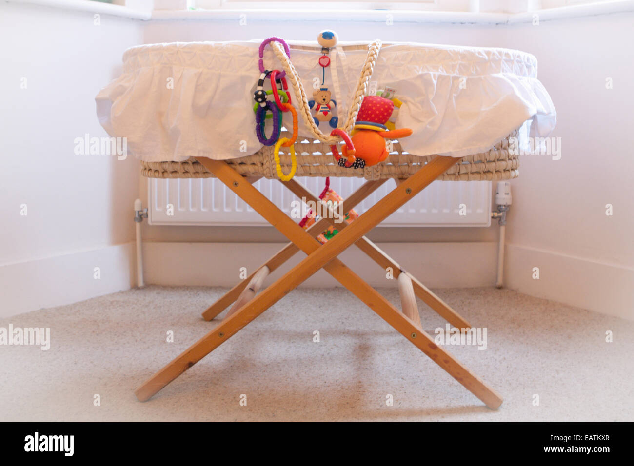 Toys hanging of a moses basket - Stock Image