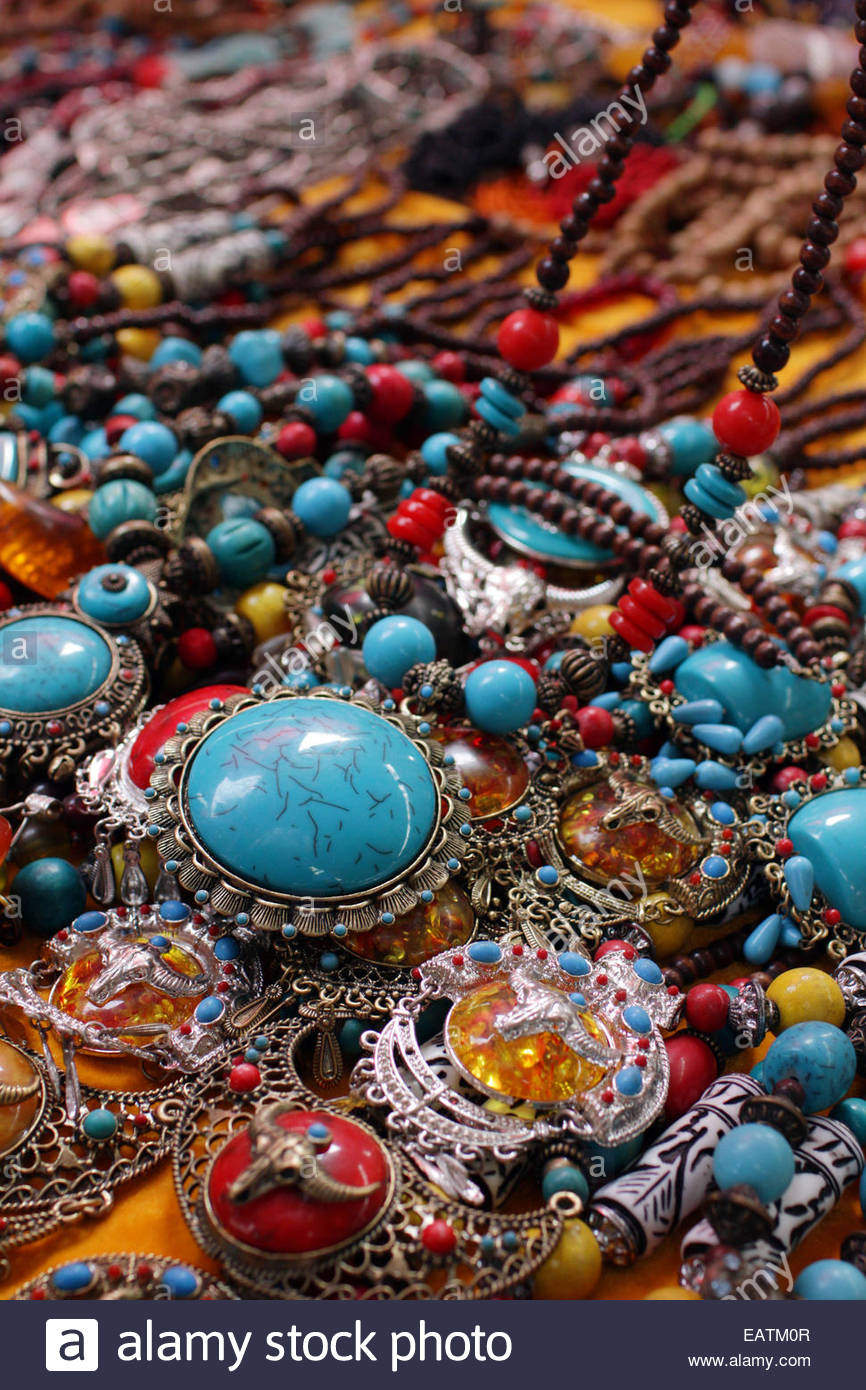 Tibetan jewelry for sale at the Panjiayuan antique market. - Stock Image