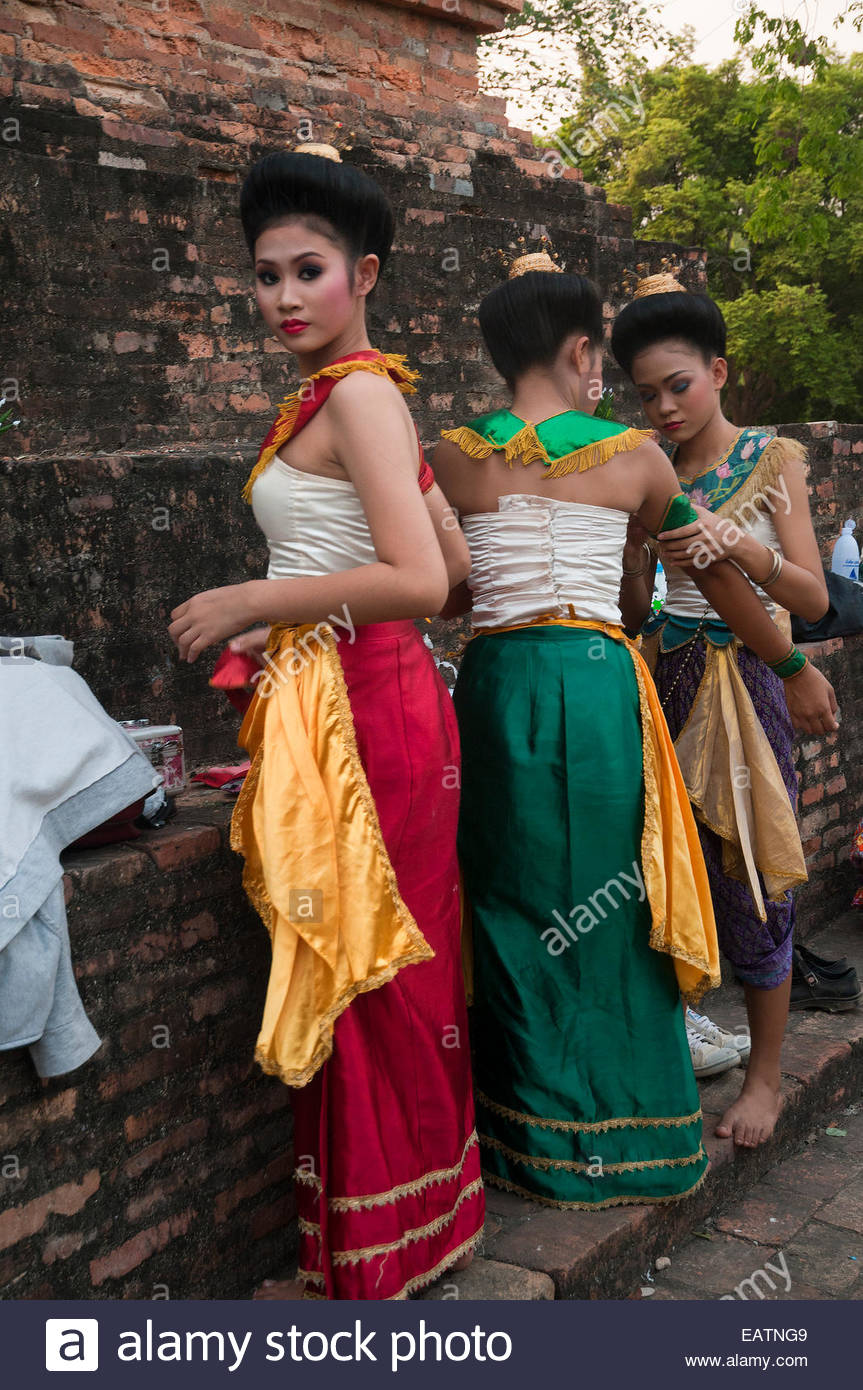 Women prep for a dance by Wat Sa Sri Temple. - Stock Image