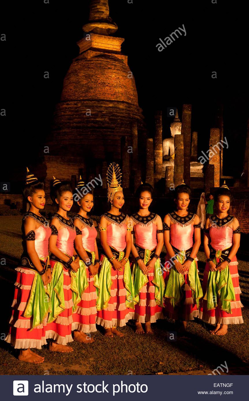 A group of young performers stand outside Wat Sa Sri Temple. - Stock Image