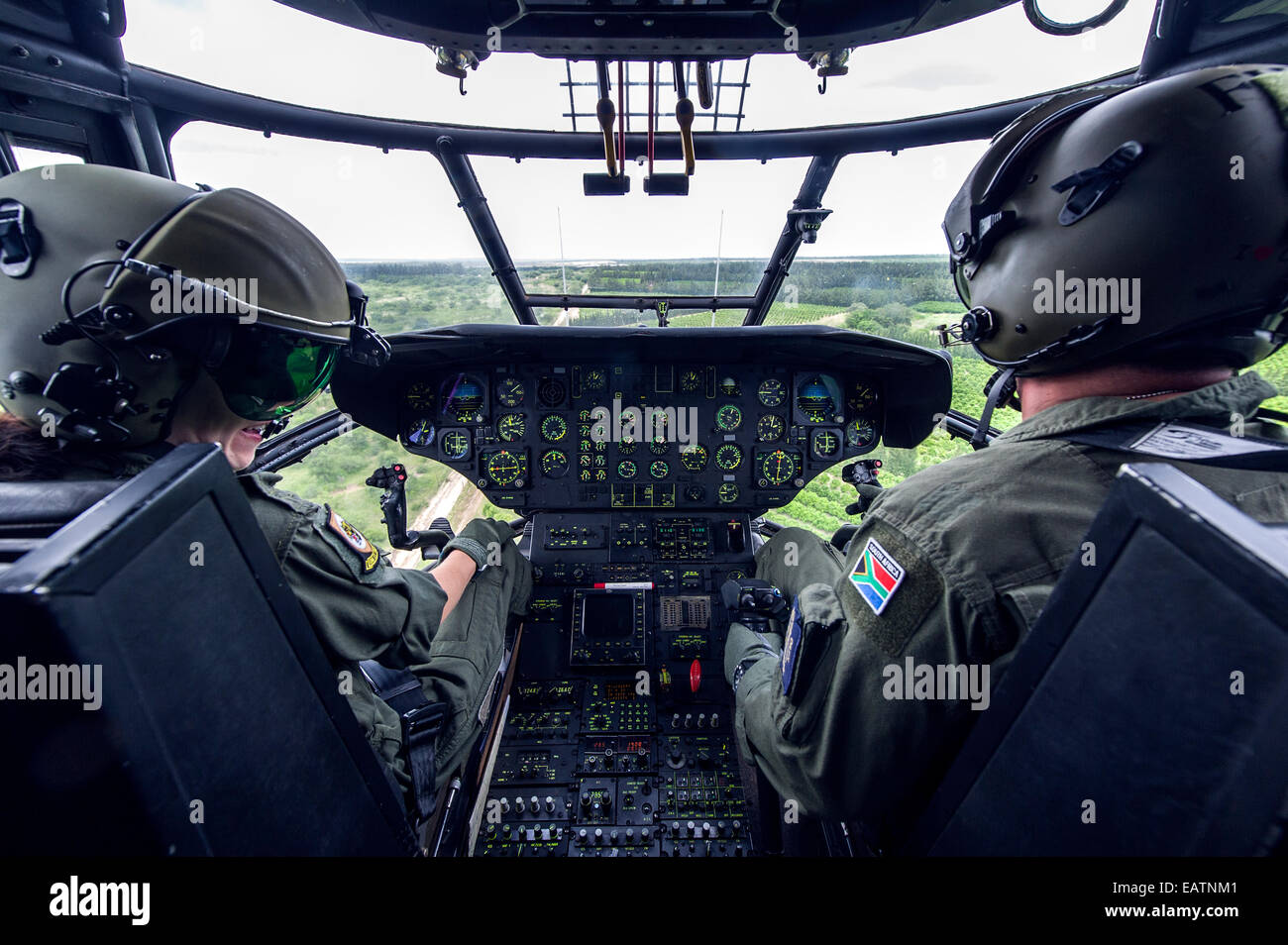 The pilot flight crew of an Atlas Oryx airforce helicopter on patrol. - Stock Image