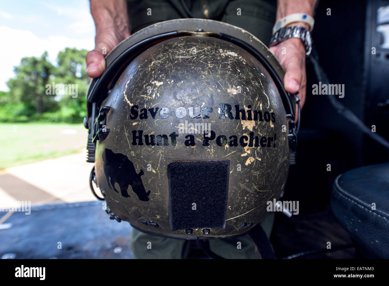 Airforce helmet with Rhinoceros anti-poaching slogan on the back. - Stock Image