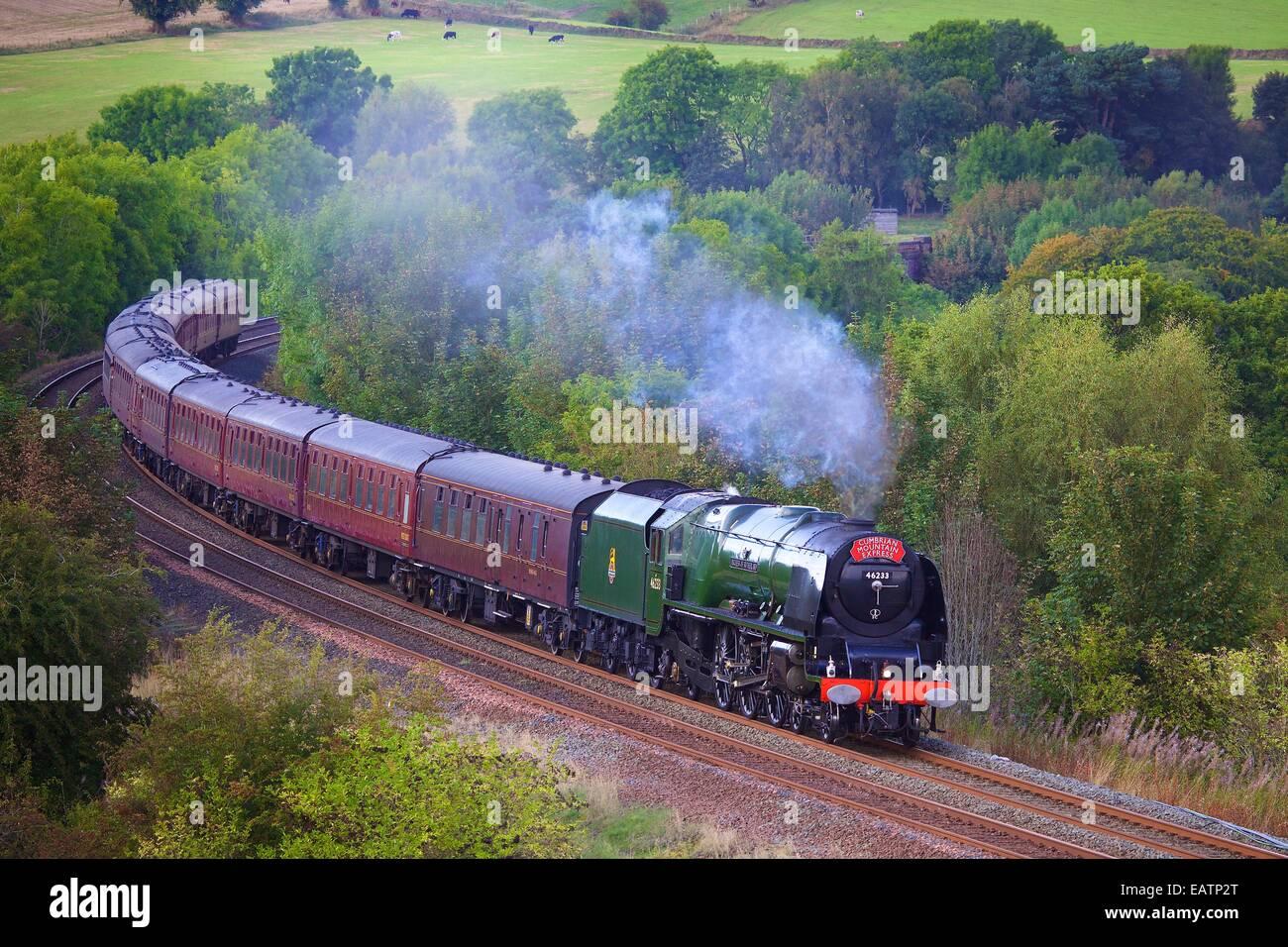 Steam locomotive Duchess of Sutherland near Low Baron Wood Farm Armathwaite Eden Valley, Cumbria, England, UK. - Stock Image