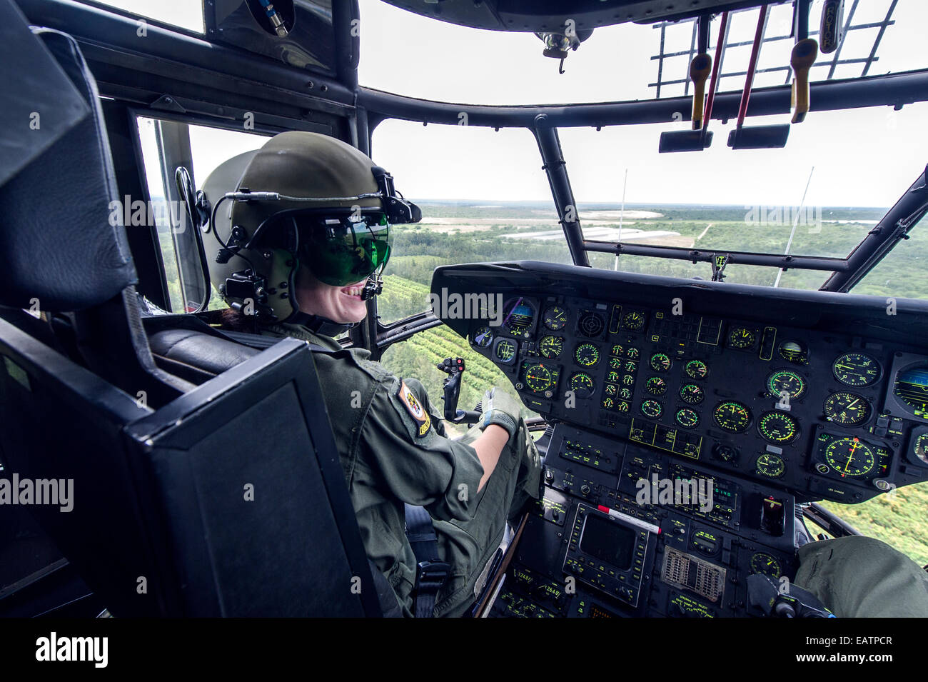 An Atlas Oryx Helicopter Pilot At The Flight Controls In