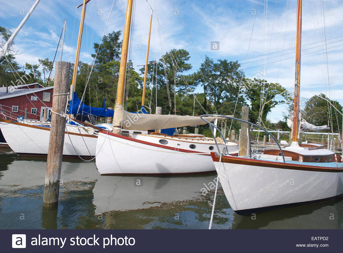 Beautiful wooden boats tied up at a marina in Maryland. - Stock Image