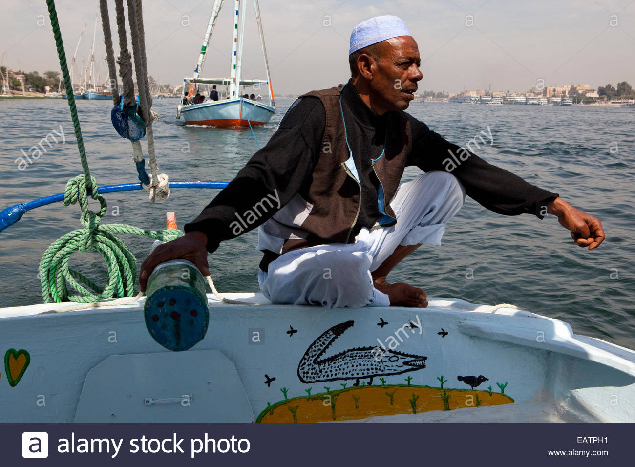 Traditional sailing vessels, feluccas, in the Nile River, Luxor. - Stock Image