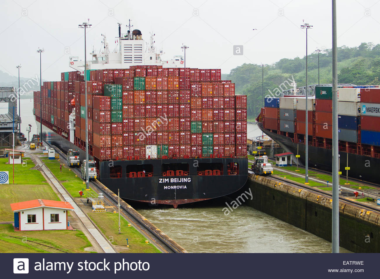 A Panamax ship at full capacity squeezes through the Miraflores Locks. - Stock Image