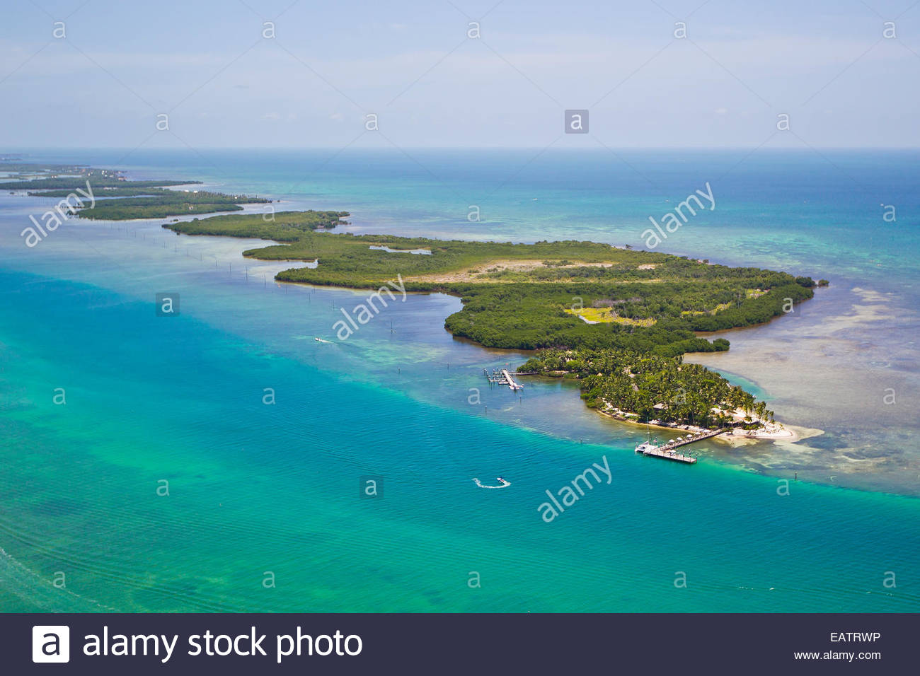 Aerial view of a secluded island with only a few homes. - Stock Image