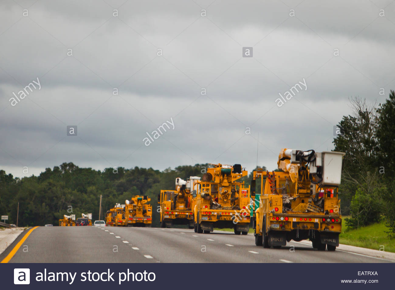 Utility workers head to the Gulf Coast, ground zero of Hurricane Isaac, to repair destruction. - Stock Image