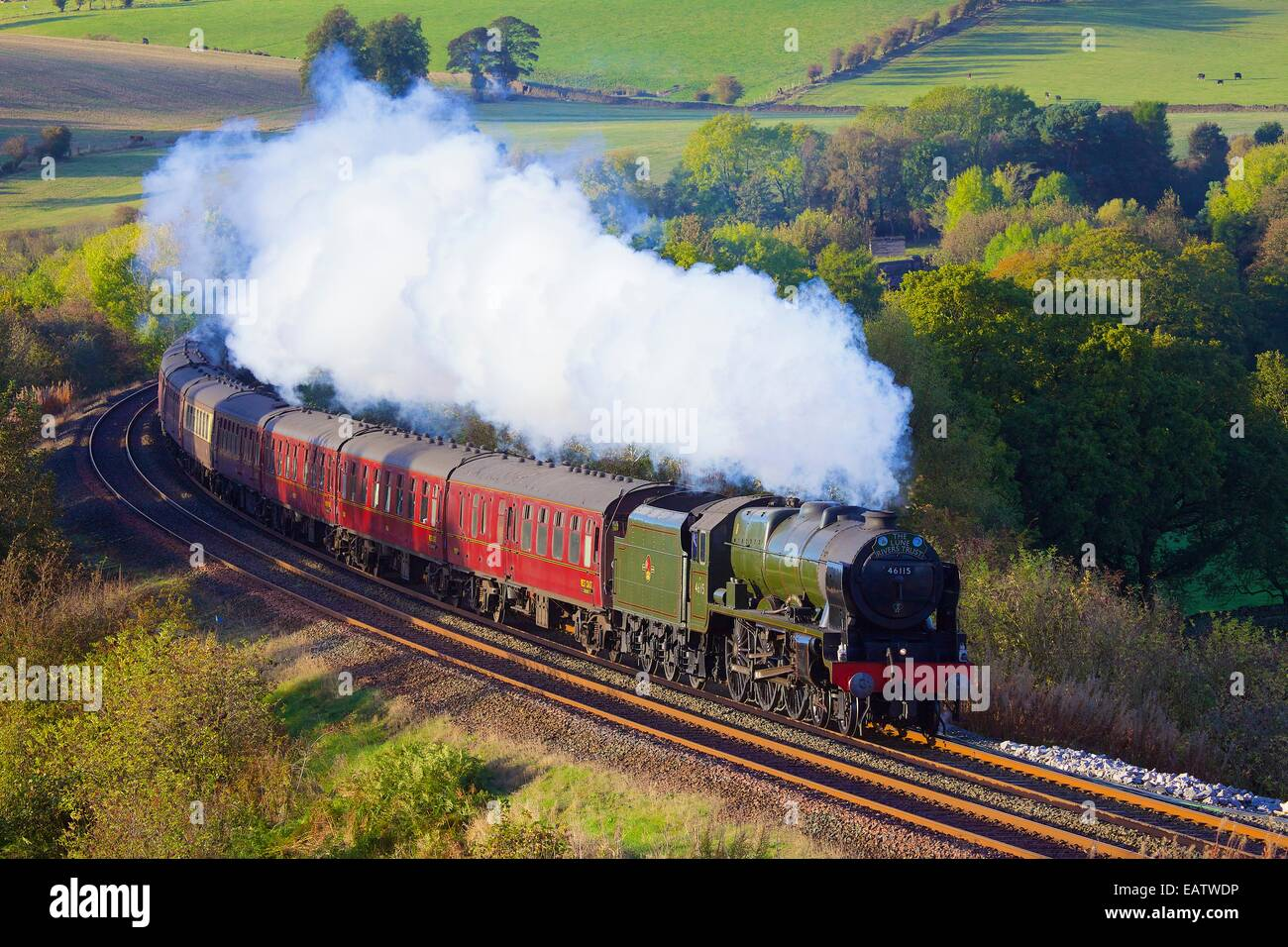 Steam locomotive LMS Royal Scot Class 46115 Scots Guardsman near Low Baron Wood Farm Armathwaite, Eden Valley, Cumbria, - Stock Image