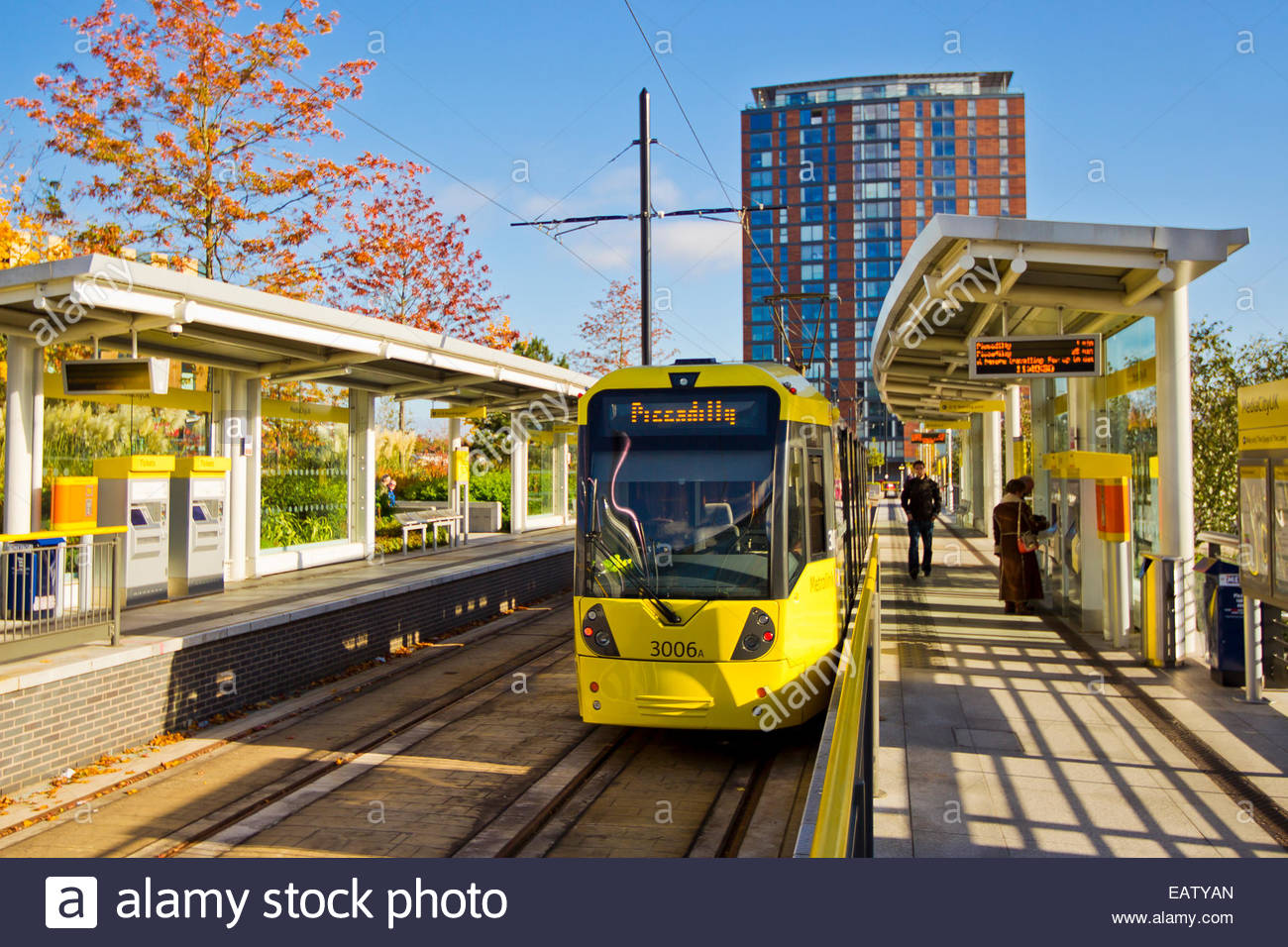 A commuter train stops for passengers at the Media City station. - Stock Image