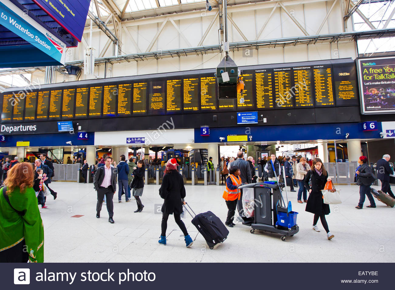 People scramble to catch their train at Waterloo Station in London. Stock Photo