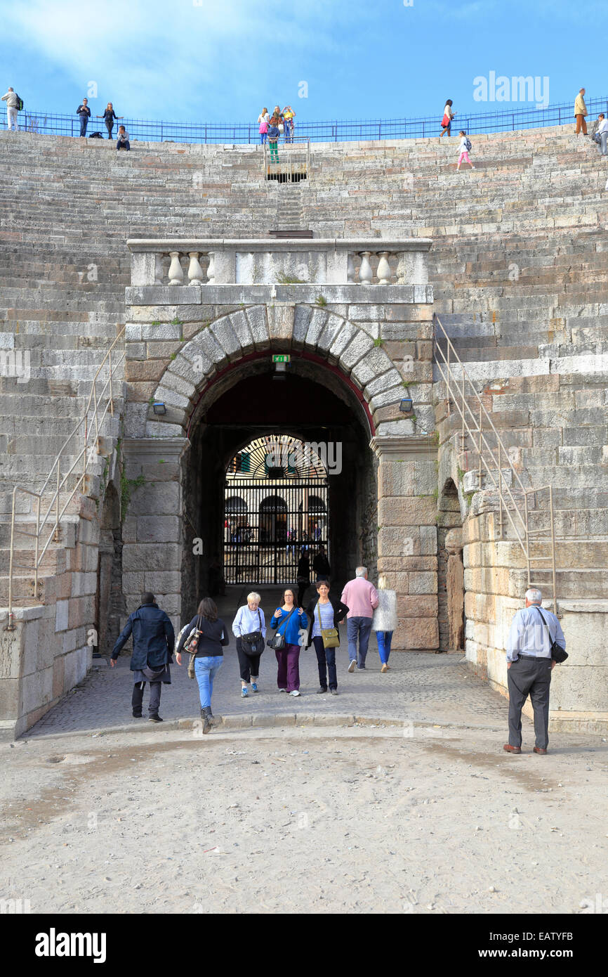 Tourists in the Arena amphitheater entrance archway, Verona, Italy, Veneto. - Stock Image