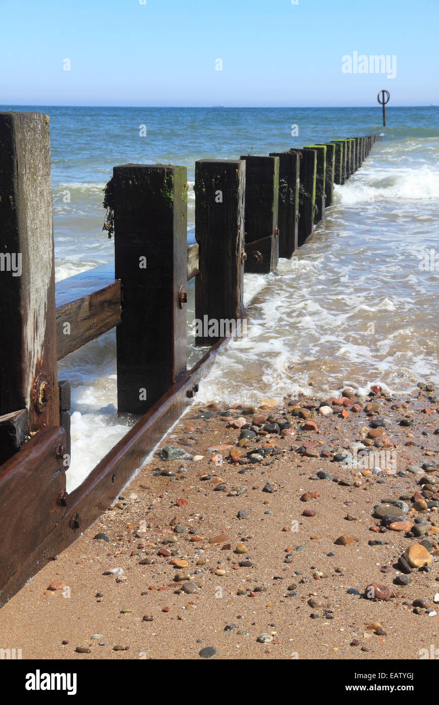 Waves rolling in from the North Sea onto the groynes at Aberdeen beach, Scotland - Stock Image